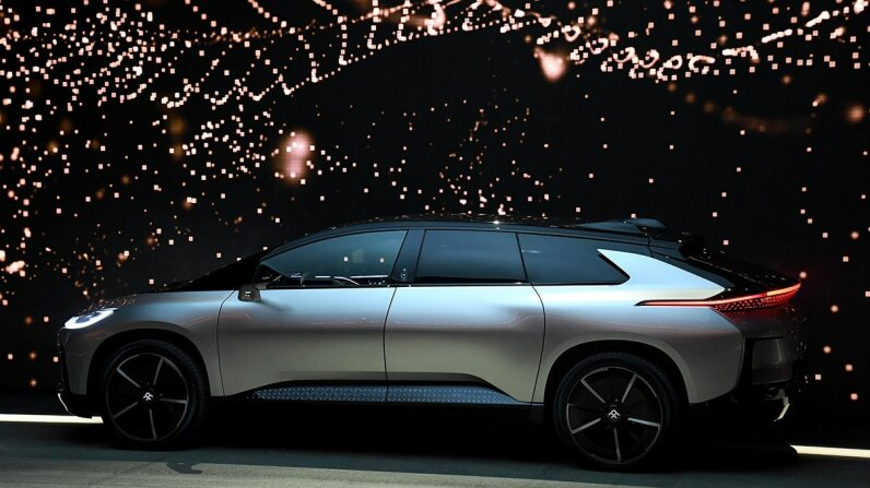 Faraday Futures new electric crossover vehicle poses at CES 2017. Ethan Miller/Getty Images