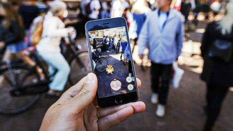 """Pokemon Go"" lets players search the real world for virtual creatures to catch. REM KODEWAAL/AFP/Getty Images"