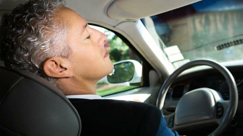 Strangely enough, none of the car manufacturers with semi-autonomous models had press images of people passed out behind the wheel. So instead we give you this well-coiffed guy pretending to be asleep. You get the idea. Jupiterimages/Getty Images