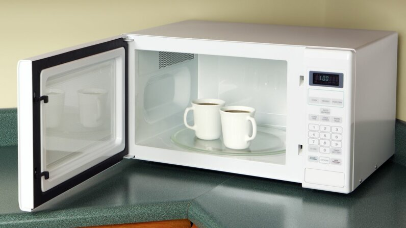 Is it perception? Is it chemical? Why do some hate the taste of coffee reheated in the microwave oven? Don Nichols/Getty Images
