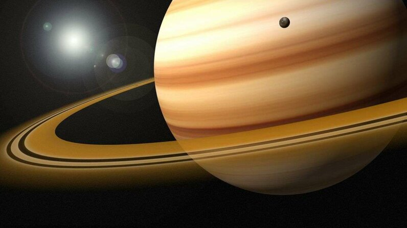 A new theory on the origin of Saturn's rings suggests they may be 4 billion years old, created from the destruction of dwarf planets. Jason Reed/Getty Images