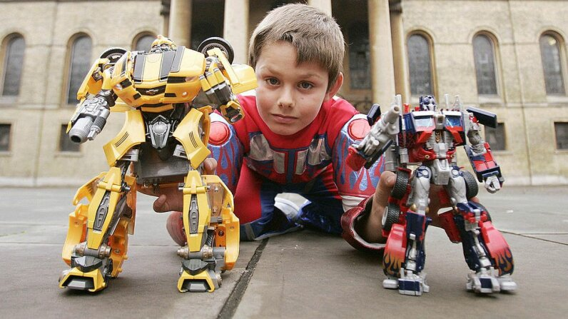 A boy plays with Transformer figures back in 2007. The toys you play with in childhood clearly leave a mark on your memory. SHAUN CURRY/AFP/Getty Images)