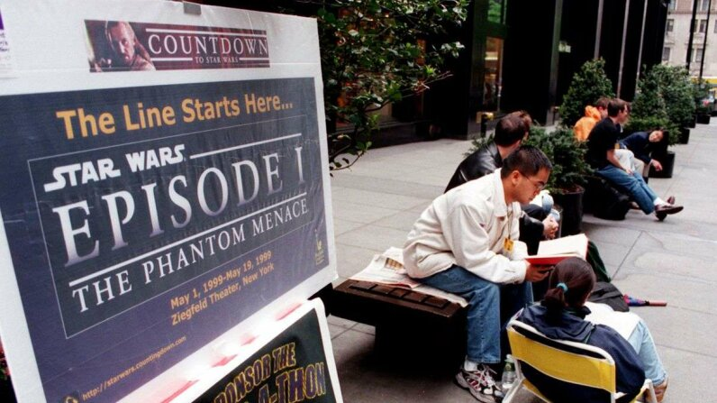 "Fans camping out in line at the Ziegfeld Theatre in New York for the opening of ""The Phantom Menace"" in 1999. STAN HONDA/AFP/Getty Images"