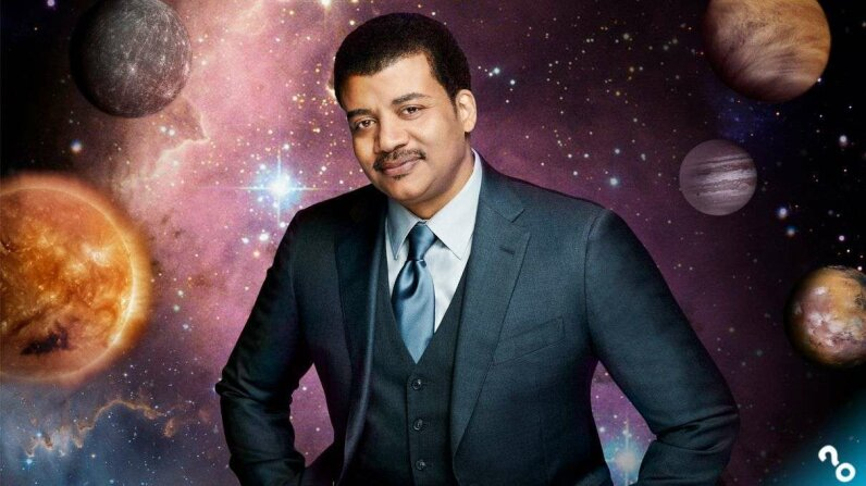 "Astrophysicist Neil deGrasse Tyson breaks down complex cosmic issues with Josh Clark and Chuck Bryant, the hosts of HowStuffWorks podcast ""Stuff You Should Know."" PatrickEccelsine/Fox/Getty Images"