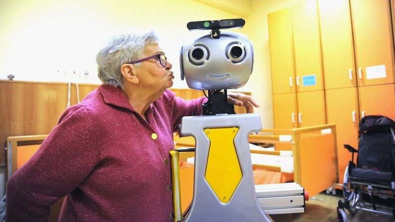 In an assisted living home in Italy, a robot, pictured here in December 2015, acts as a caregiver or butler for the 20 elderly guests. Robots developed by the Robotics Institute of the Scuola Superiore Sant'Anna di Pisa are designed and programmed to p... Laura Lezza/Getty Images