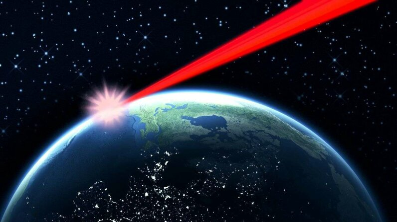 A laser beam based on Earth or placed in orbit could obscure the transit of Earth from prying alien eyes. Loops7/Bethany Clarke/Getty