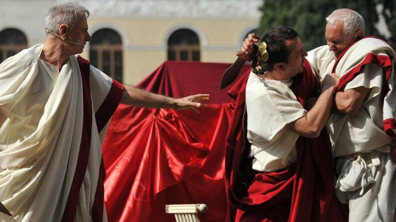 TheassassinationofJuliusCaesar (as reconstructed by a Roman historian group) is one of the most famous betrayals in history. Could Caesar have been clued in to his untimely demise through language? TizianaFabi/AFP/Getty