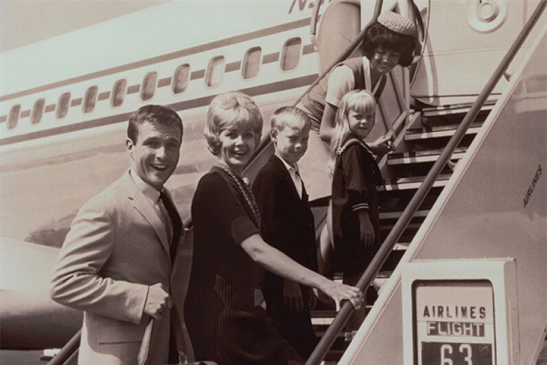 Hard to believe now, but there was a time when the whole family dressed up to board a plane. FPG/The Image Bank/Getty Images