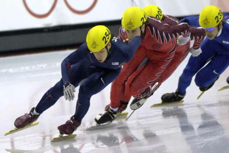 Apolo Anton Ohno (front) of the U.S in action during the short track speed skating 500 meters at the 2006 Turin Games. S. Levin/Getty Images