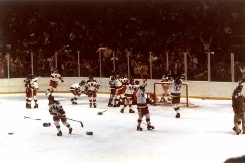 Team USA celebrates their 4-3 victory over the Soviet Union in the semi-final men's ice hockey event in 1980. The game was dubbed the 'Miracle on Ice' because the Soviets had won every Olympic event since 1954. The USA went on to win the gold. B Bennett/Getty Images