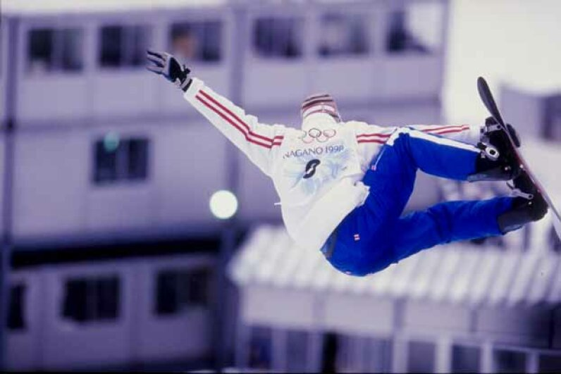 Jonathan Collomb-Patton of France competes in a snowboarding event during the Winter Olympics in Nagano, Japan. This was the first Olympics to feature snowboarding. Doug Pensinger /Allsport