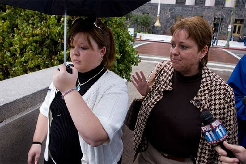Lori Drew (R) and her daughter Sarah Drew, who was Megan Meier's former friend, leave the U.S. Federal Courthouse in Los Angeles in 2008. The jury returned three guilty verdicts against Lori Drew, but a federal judge later overturned them. © Ted Soqui/Corbis