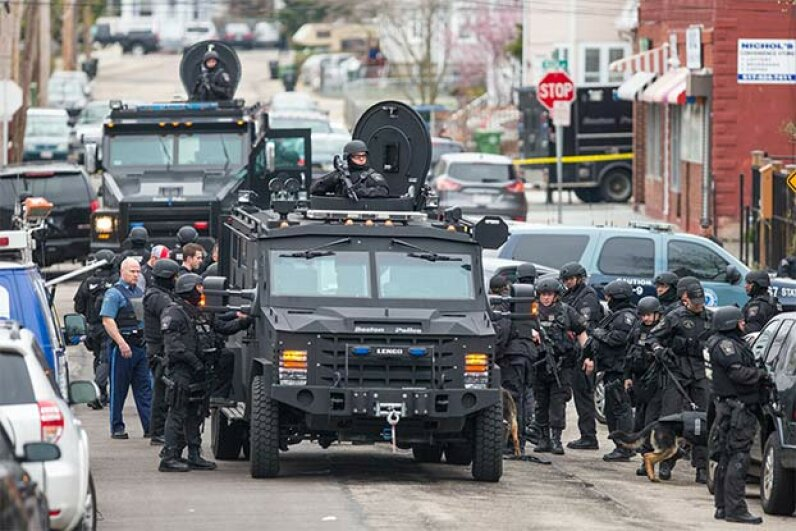 SWAT teams move into position in Massachusetts while searching for a marathon bombing suspect. Phoning in a fake 9-1-1 call about a serious crime can result in a SWAT team descending on an unsuspecting target, a dangerous practice called swatting. Aram Boghosian for The Boston Globe via Getty Images