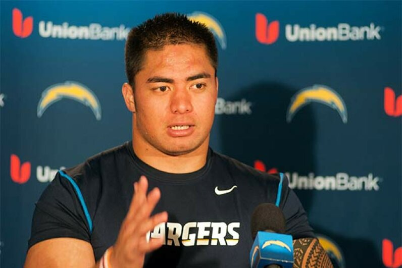 Manti Te'o of the San Diego Chargers speaks with members of the media in 2013. He was victim of a catfish scheme that year. Kent C. Horner/Getty Images