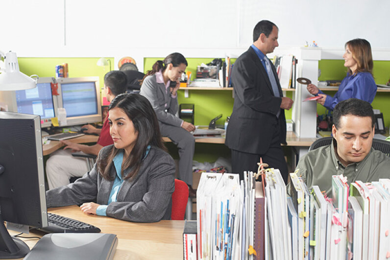 How can you get your work done in an open plan office? We've got some tips. Jack Hollingsworth/Photodisc/Thinkstock