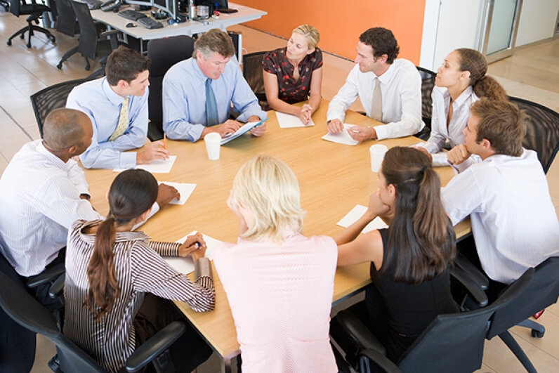 If you're having problems with your new office space, schedule a meeting to discuss a few ground rules. Monkey Business Images/Stockbroker/Thinkstock
