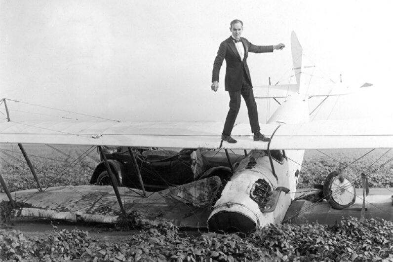 "Ormer Locklear walks on the wings of an airplane in a still from the 1920 silent film ""The Skywayman."" Locklear later died while performing an aerial maneuver during nighttime shooting for the movie. Hulton Archive/Getty Images"