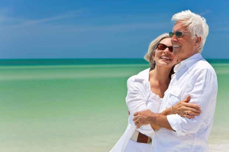 This is the dream of retirement -- happy couple on the beach.  But what is the reality? Ingram Publishing/Thinkstock