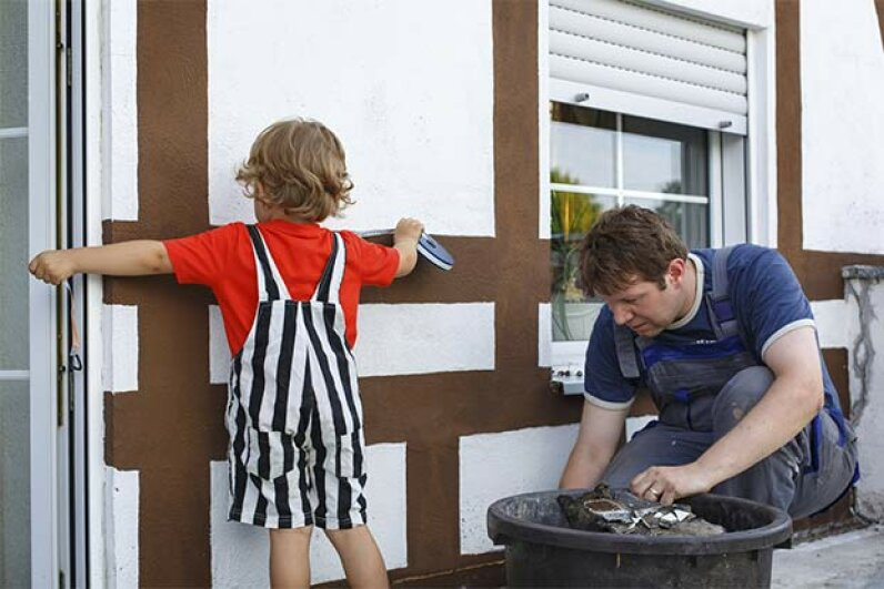 Even a little help is a good thing when you're painting the outside of your house. See pictures of home design. romrodinka/iStock/Thinkstock