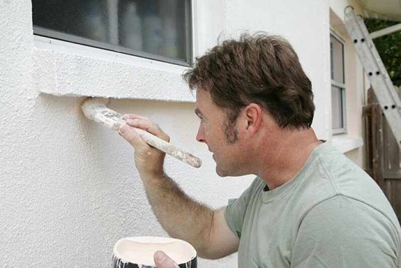 Housepainting requires a certain technique and finesse to look professional. Lisa F. Young/iStock/Thinkstock