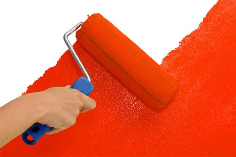 Rollers can cover large areas of wall much faster than brushes. Blaz Kure/Hemera/Thinkstock