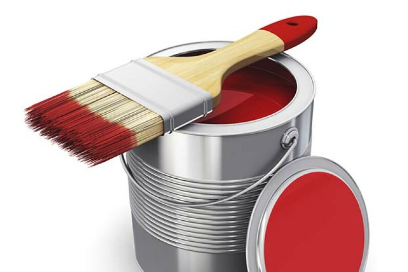 For best results, dip your paintbrush bristles about 2 inches into the can and shake off the excess against the sides of the container. scanrail/iStock/Thinkstock