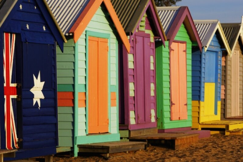 The paint jobs on those beach huts look professional. You can bet whoever painted them accounted for weather (and exposure to salt water). Davis McCardle/Digital Vision/Thinkstock