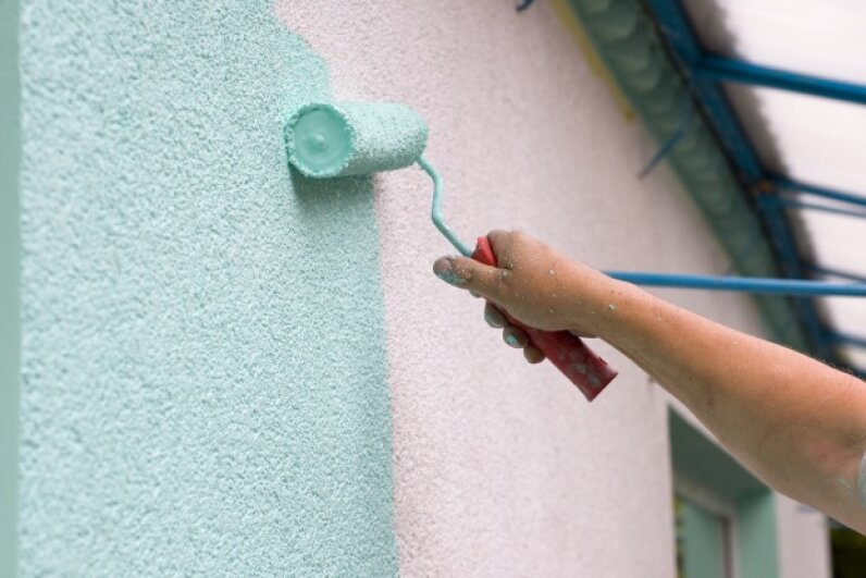 That minty ice cream color paint is going to adhere better to the stucco if you use the right roller (in this case, probably one with a 3/4 inch nap). Viktoriia Khorzhevska/Hemera/Thinkstock