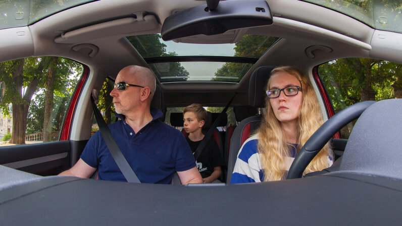 teen and parent driving
