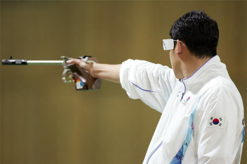 Jin Jong-oh of South Korea competes in the men's 50-meter air pistol event at the 2004 Athens Olympics. Believe it or not, pistol shooters have been known to dope, too. Ezra Shaw/Getty Images