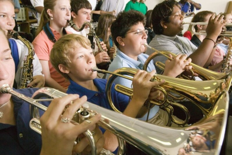 These kids probably don't think of it this way, but as they practice their instruments, they're learning to control sound waves. ©Tim Pannell/Fuse/Thinkstock