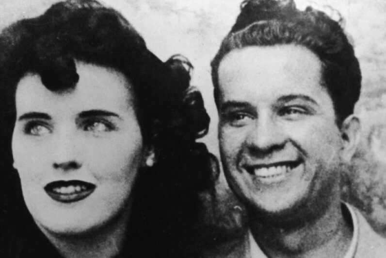 Elizabeth Short, aka the Black Dahlia, smiles at the camera for a picture that may have been taken in a photography booth in the mid-1940s. The man on the right is unidentified. Could he have known anything about her murder? International News Photo/AFP/Getty Images
