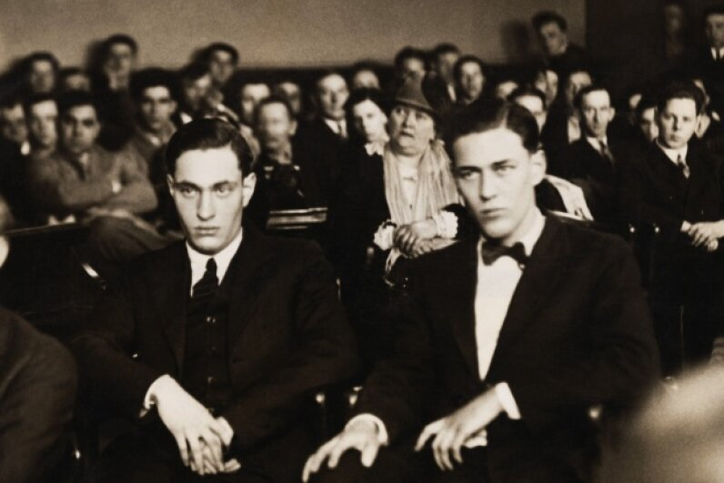 The hearing and sentencing of Nathan Leopold (L) and Richard Loeb (R) represents a major milestone in the history of the U.S. legal system and the death penalty. Leopold and Loeb's lawyer, Clarence Darrow, successfully argued against capital punishment.  © Underwood & Underwood/Corbis