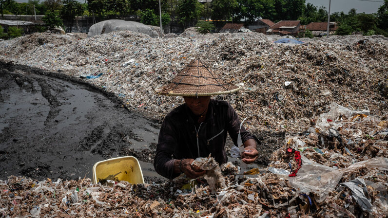 man collects plastic to recylce, Indonesia