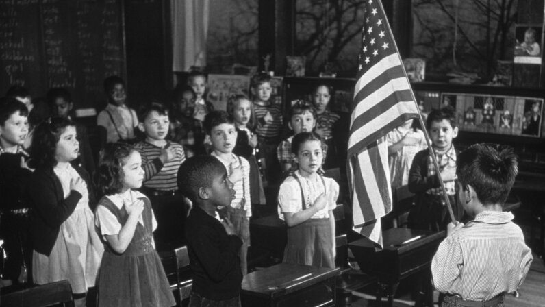 boy and class reciting pledge of allegiance