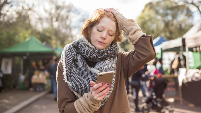 red-haired woman in London looking tired in market