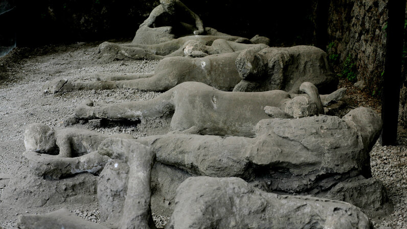 plaster casts of victims at the Garden of Fugitives in Pompeii