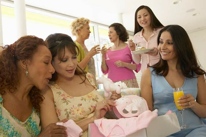 You'll be sure to hear a lot of pregnancy superstitions at a baby shower. Barry Austin/Photodisc/Thinkstock
