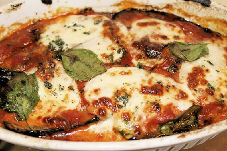 Does this Scalini's Italian Restaurant's eggplant parmesan really bring on labor. You can find out for yourself with this recipe. marcobir/iStock/Thinkstock