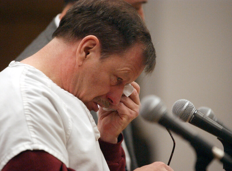 Green River Killer Gary Leon Ridgway cries as he reads a statement in court, Dec. 18, 2003, in Seattle. Ridgway received 48 life sentences, without the possibility of parole, for killing 48 women. Elaine Thompson-Pool/Getty Images