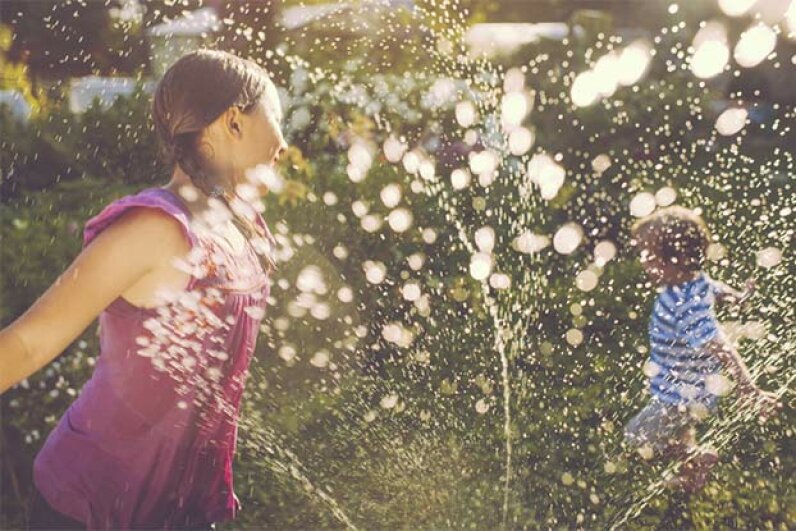You can easily create a rainbow using a garden hose and the sun. ArtMarie/Getty Images