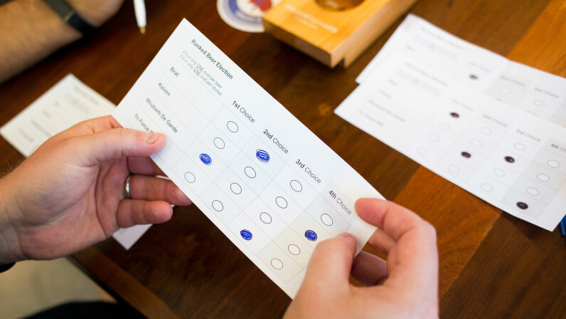 Kyle Bailey, campaign manager for the Committee for Ranked Choice Voting, counts up the votes in a demonstration of ranked-choice voting at Foulmouthed Brewing in Portland, Maine. Maine is the first state to use ranked-choice voting for statewide races. rianna Soukup/Portland Press Herald via Getty Images