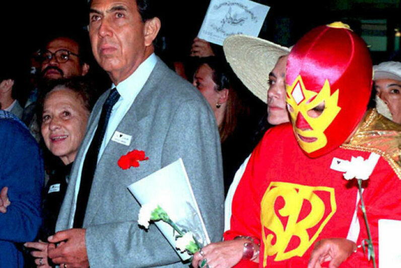 Superbarrio has been fighting the fight for years. This photo of the caped crusader with politician Cuauhtemoc Cardenas was taken in 1995. ©JORGE UZON/AFP/Getty Images