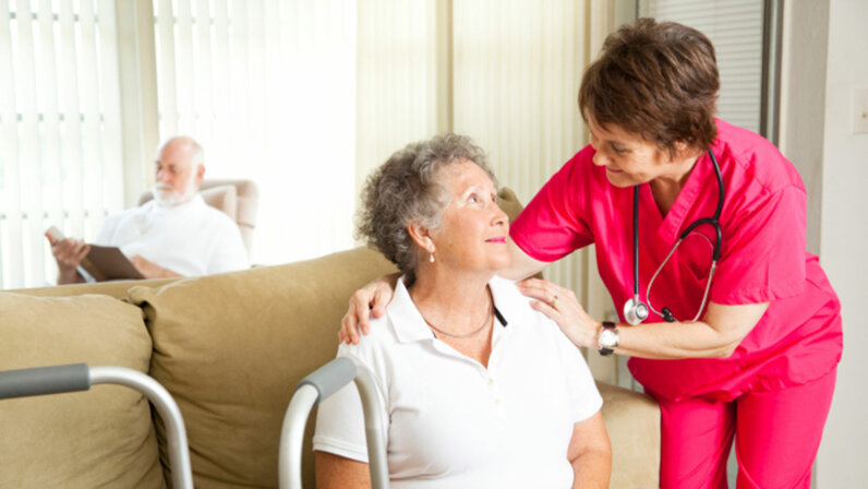 nurse taking care of elderly woman