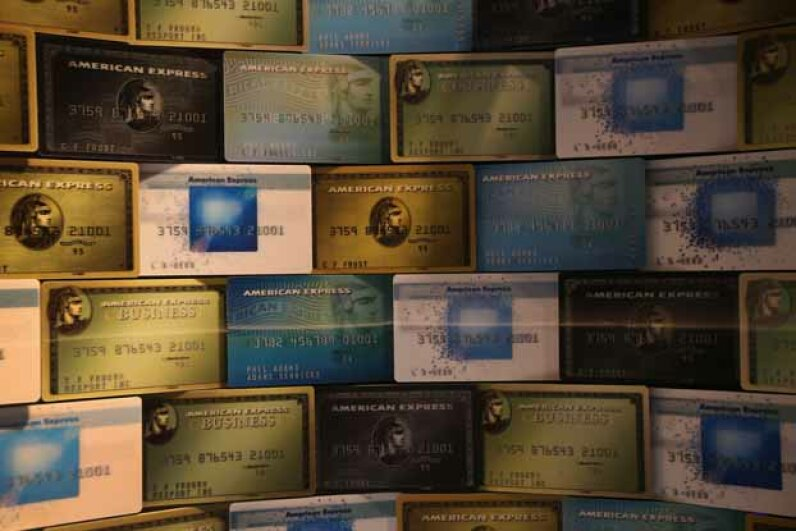 Credit cards fill a window display at American Express headquarters in New York City. American Express actually started out as a package delivery service. John Moore/Getty Images