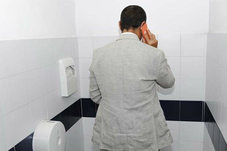 Think of the germs your phone picks up when you're talking in the toilet -- not to mention the danger that the phone falls in. Gianluca Rasile/iStock/Thinkstock