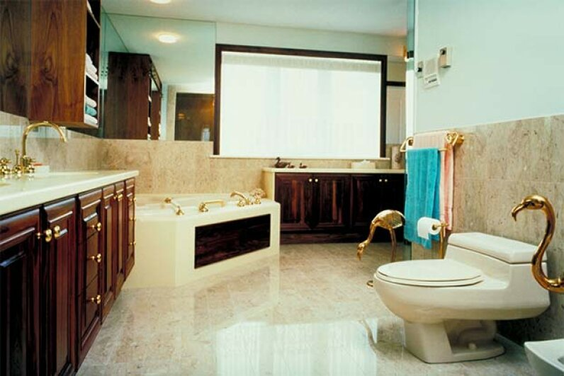A well-appointed guest bathroom is  a thing of beauty; make sure there's extra soap, guest towels and -- most important -- extra toilet paper. Jupiterimages/Photos.com/Thinkstock