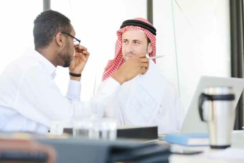 The First Amendment allows you to discuss religious and political matters at work but employers can forbid it if they find it disruptive to the workplace. iStock/Thinkstock