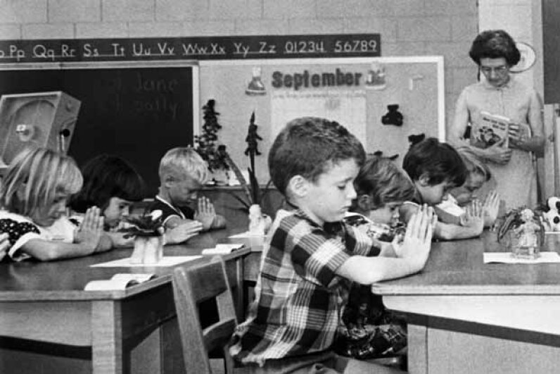 """First graders pray silently in a South Carolina public school in 1966. At the time, the state's school districts left the """"prayer issue"""" to the teacher's discretion. © Bettmann/CORBIS"""