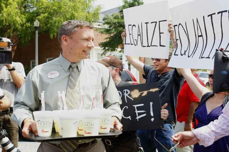 A Chick-Fil-A employee tries to hand out lemonade during a protest at a Chick-Fil-A restaurant in Decatur, Ga. in 2012. People protested the chain nationwide after the COO (the son of the founder) voiced opposition to gay marriage. © TAMI CHAPPELL/Reuters/Corbis